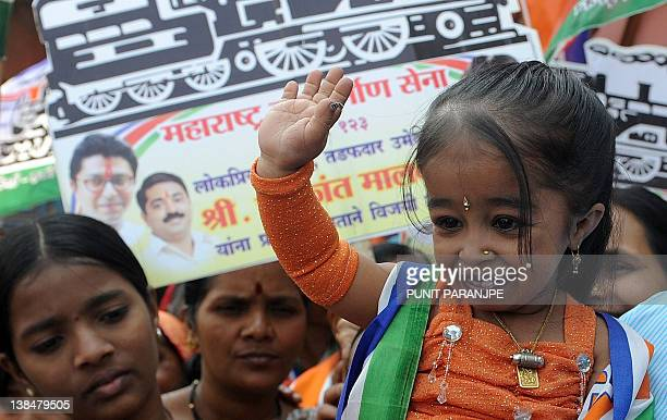 Jyoti Amge world's shortest woman living waves to local residents while campaigning for a local political party in Mumbai on February 7 2012 Jyoti...