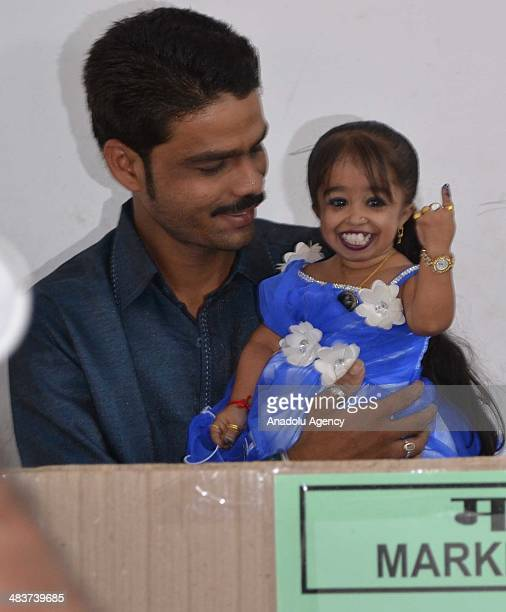 Jyoti Amge worlds smallest woman certified by Guinness Book of World Records casts her vote for the Indian general election in Nagpur city of western...