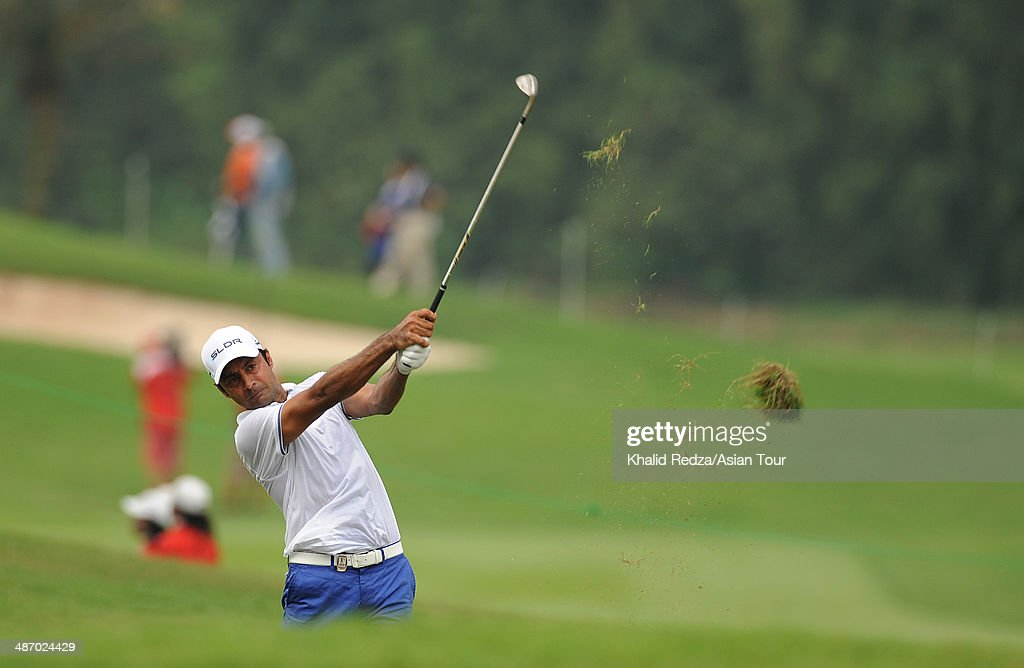 Jyoti Randhawa of India plays a shot during round four of the CIMB Niaga Indonesian Masters at Royale Jakarta Golf Club on April 27, 2014 in Jakarta, Indonesia.