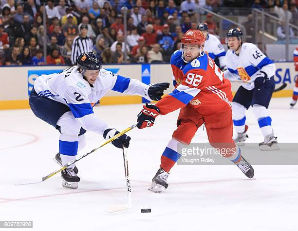 Jyrki Jokipakka of Team Finland battles for the puck with Evgeny Kuznetsov of Team Russia during the World Cup of Hockey 2016 at Air Canada Centre on...