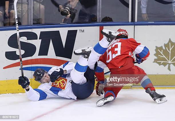 Jyrki Jokipakka of Team Finland is upended by Evgeny Dadonov of Team Russia during the World Cup of Hockey tournament at the Air Canada Centre on...
