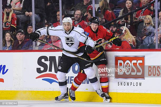 Jyrki Jokipakka of the Calgary Flames collies with Andy Andreoff of the Los Angeles Kings during an NHL game at Scotiabank Saddledome on April 5 2016...