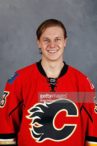 Jyrki Jokipakka of the Calgary Flames gets his headshot taken before an NHL game against the Arizona Coyotes at Scotiabank Saddledome on March 11...