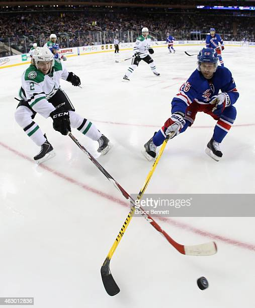 Jyrki Jokipakka of the Dallas Stars and Martin St Louis of the New York Rangers pursue the puck during the first period at Madison Square Garden on...