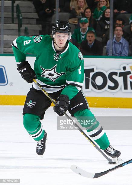 Jyrki Jokipakka of the Dallas Stars handles the puck against the Calgary Flames at the American Airlines Center on January 25 2016 in Dallas Texas