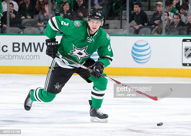 Jyrki Jokipakka of the Dallas Stars handles the puck against the New York Islanders at the American Airlines Center on March 3 2015 in Dallas Texas