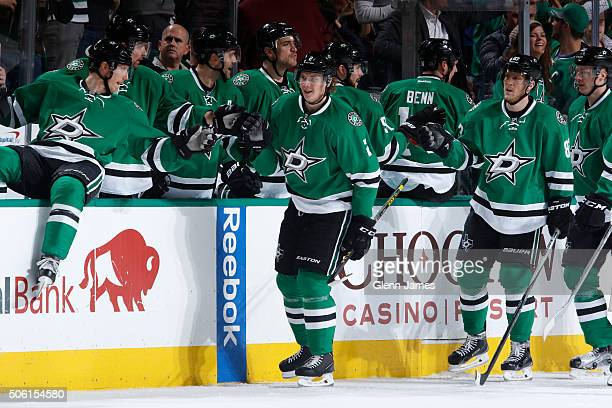 Jyrki Jokipakka of the Dallas Stars is congratulated by his teammates after scoring a goal against the Edmonton Oilers at the American Airlines...
