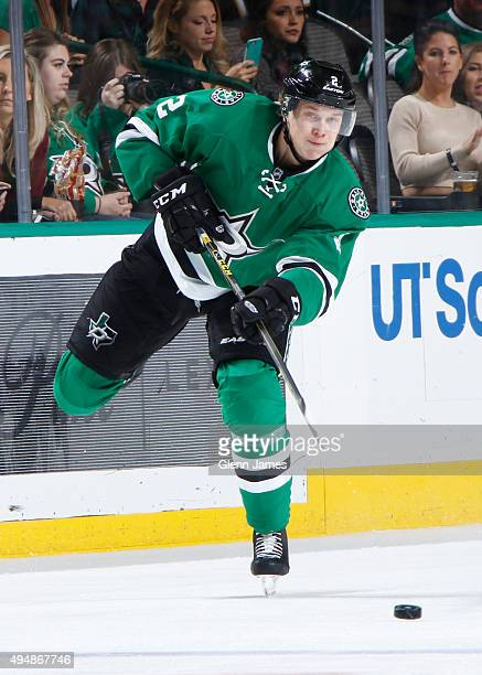 Jyrki Jokipakka of the Dallas Stars makes a pass to a teammate against the Vancouver Canucks at the American Airlines Center on October 29 2015 in...