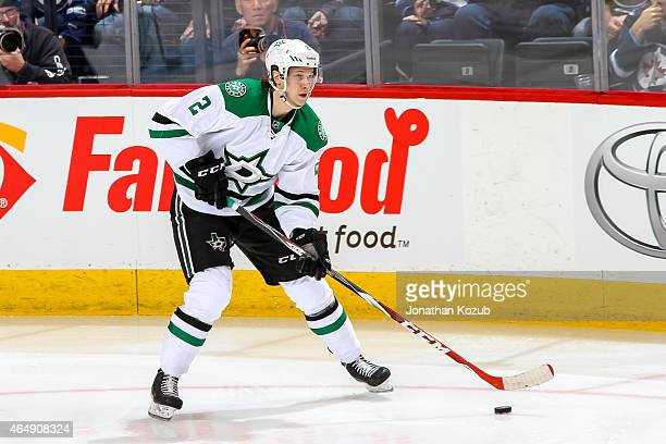 Jyrki Jokipakka of the Dallas Stars plays the puck up the ice during second period action against the Winnipeg Jets on February 24 2015 at the MTS...