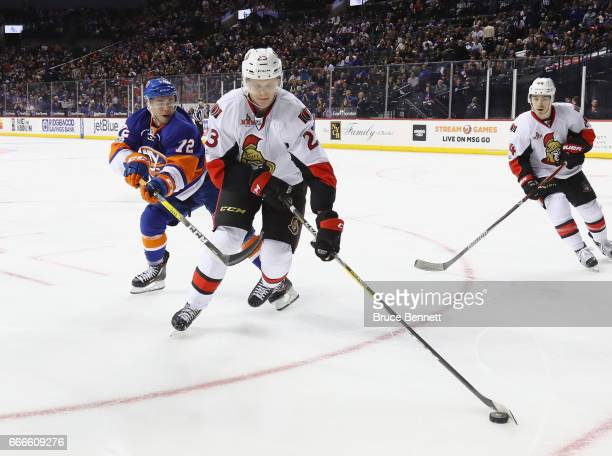 Jyrki Jokipakka of the Ottawa Senators moves the puck away from Anthony Beauvillier of the New York Islanders during the second period at the...