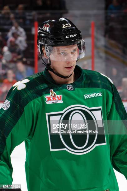 Jyrki Jokipakka of the Ottawa Senators skates wearing a green jersey for St Patrick's day during warmups prior to a game against the Chicago...