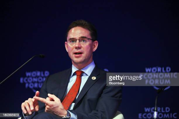 Jyrki Katainen Finland's prime minister gestures as he speaks during the World Economic Forum Annual Meeting Of The New Champions in Dalian China on...