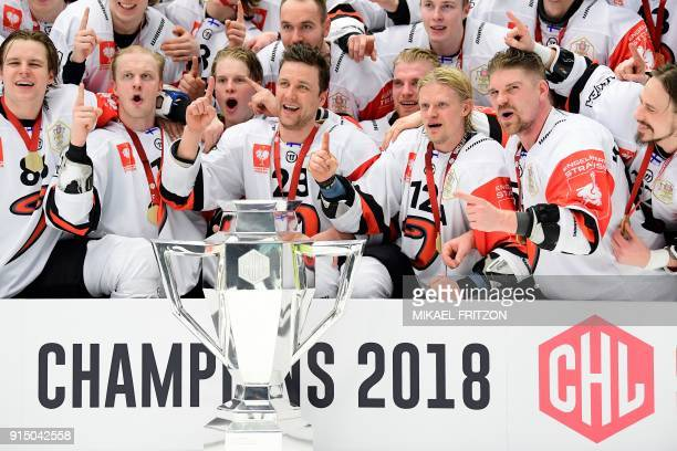 Jyvaskyla's players celebrate after winning the Champions Hockey League final match between Vaxjo Lakers and JYP Jyvaskyla at the Vida Arena in...