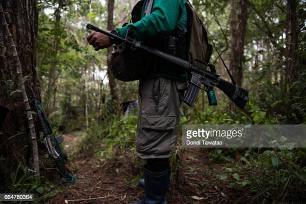 Ka Adel stands with his firearm at the camp of the New People's Army on April 2 2017 in the remote hinterlands of Mountain Province Philippines Ka...