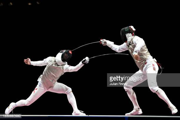 Ka Long Cheung of Team Hong Kong competes against Alexander Choupenitch of Team Czech Republic in the Men's Foil Individual Fencing semifinal 2 on...
