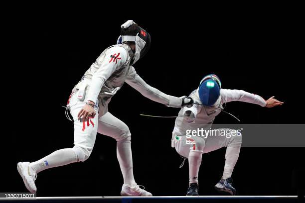 Ka Long Cheung of Team Hong Kong competes against Daniele Garozzo of Team Italy in the Men's Foil Individual Fencing Gold Medal Bout on day three of...