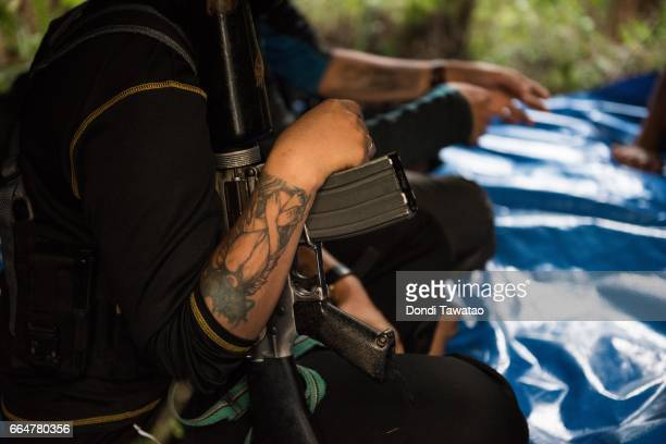 Ka Nancy sit before top officials of the New People's Army inside a tent to listen to counseling and advice before being wed on April 1 2017 in the...