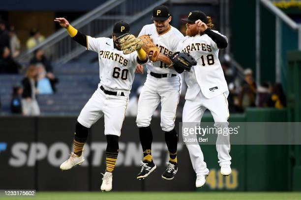 Ka'ai Tom of the Pittsburgh Pirates celebrates with Bryan Reynolds and Ben Gamel after the final out in a 4-0 win over the Colorado Rockies during...