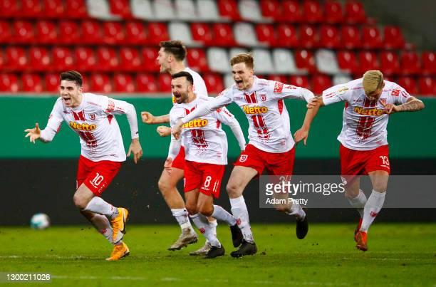 Kaan Çalışkaner, Albion Vrenezi, Scott Kennedy and Erik Wekesser of Jahn Regensburg celebrate their sides victory as Max Besuschkow of Jahn...
