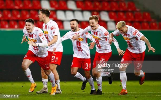 Kaan Çalışkaner, Andreas Albers, Albion Vrenezi, Scott Kennedy and Erik Wekesser of Jahn Regensburg celebrate their sides victory as Max Besuschkow...