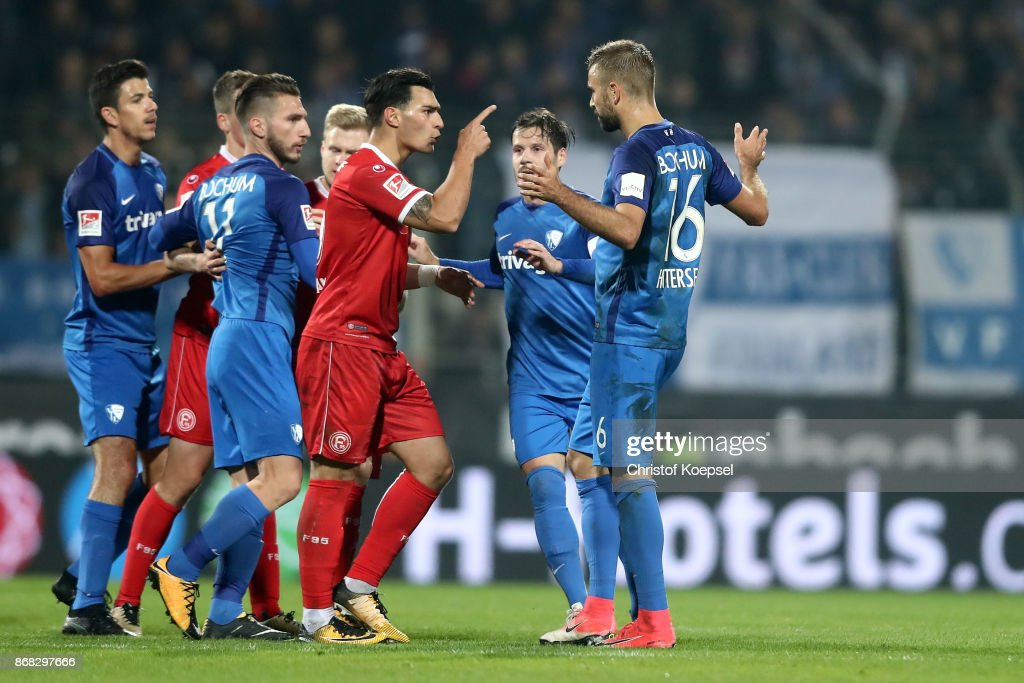 Kaan Ayhan of Duesseldorf (L) has a dispute with Lukas Hinterseer of Bochum during the Second Bundesliga match between VfL Bochum 1848 and Fortuna Duesseldorf at Vonovia Ruhrstadion on October 30, 2017 in Bochum, Germany.