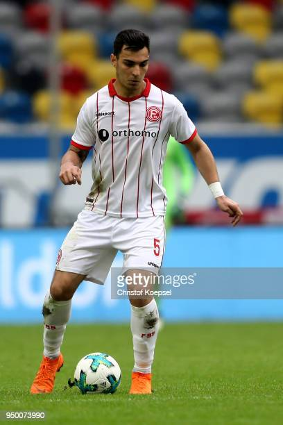 Kaan Ayhan of Duesseldorf runs with the ball during the Second Bundesliga match between Fortuna Duesseldorf and FC Ingolstadt 04 at EspritArena on...