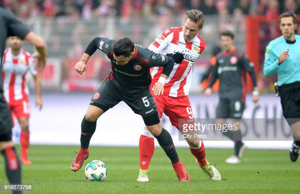 Kaan Ayhan of Fortuna Duesseldorf and Sebastian Polter of 1FC Union Berlin during the second Bundesliga game between Union Berlin and Fortuna...
