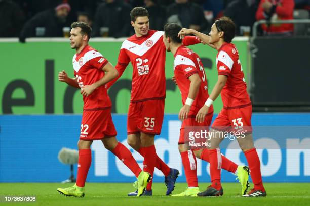 Kaan Ayhan of Fortuna Duesseldorf celebrates after scoring his team's second goal with his team mates during the Bundesliga match between Fortuna...