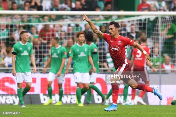 Kaan Ayhan of Fortuna Duesseldorf celebrates after scoring his team's second goal during the Bundesliga match between SV Werder Bremen and Fortuna...