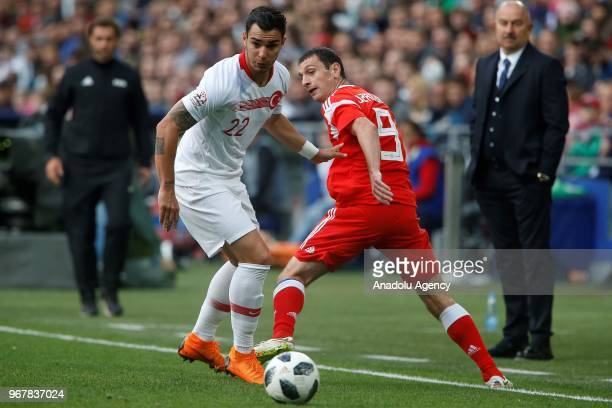Kaan Ayhan of Turkey in action against Alan Dzagoev of Russia during an international friendly match between Russia and Turkey in Moscow Russia on...