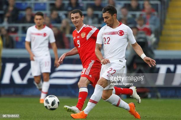 Kaan Ayhan of Turkey in action against Alan Dzagoyev of Russia during an international friendly match between Russia and Turkey in Moscow Russia on...