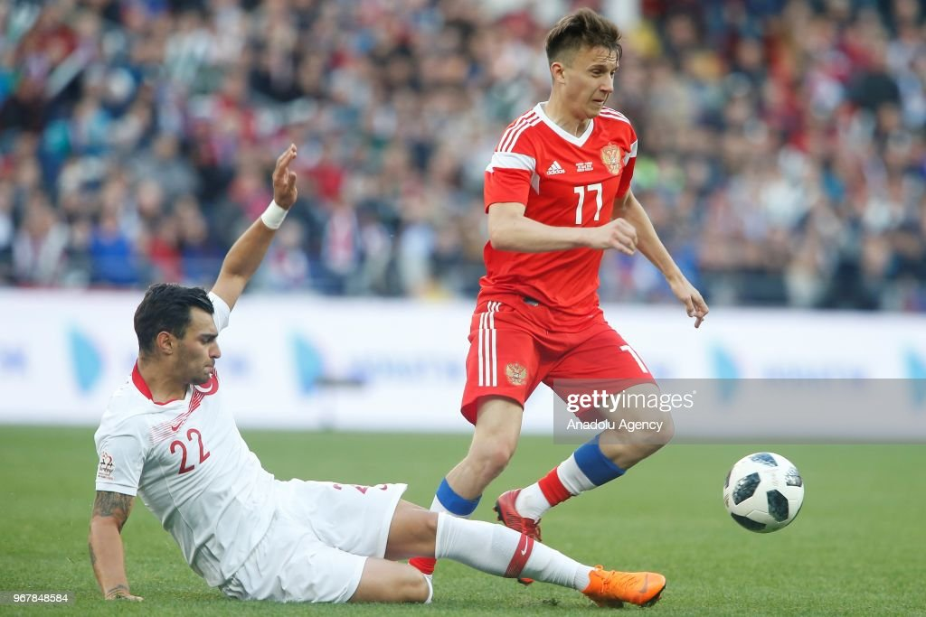 Kaan Ayhan (L) of Turkey in action against Aleksandr Golovin (R) of Russia during an international friendly match between Russia and Turkey in Moscow, Russia on June 05, 2018.