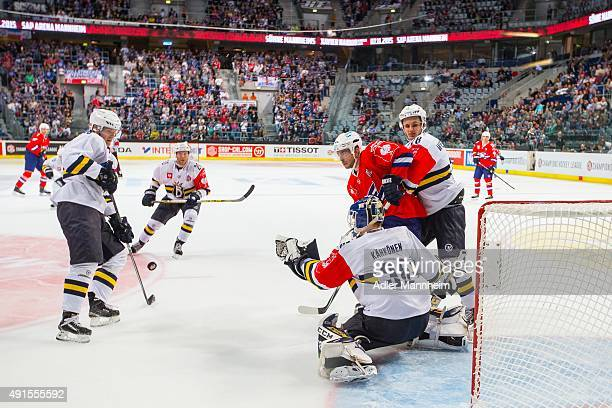 Kaaop Kahkonen and Otso Rantakari of Espoo Blues in action with Kai Hospelt of Adler Mannheim during the Champions Hockey League round of thirty-two...