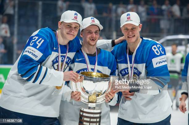 Kaapo Kakko of Finland and Harri Pesonen of Finland celebrates the win with the trophy after during the 2019 IIHF Ice Hockey World Championship...