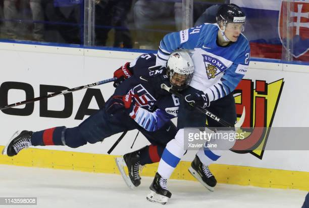 Kaapo Kakko of Finland and Jack Hughes of USA clash along the boards during the 2019 IIHF Ice Hockey World Championship Slovakia group A game between...