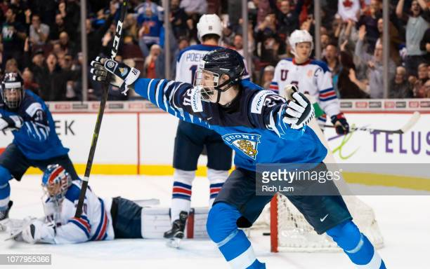 Kaapo Kakko of Finland celebrates after scoring what proved to be the game winning goal against the United States in Gold Medal hockey action of the...