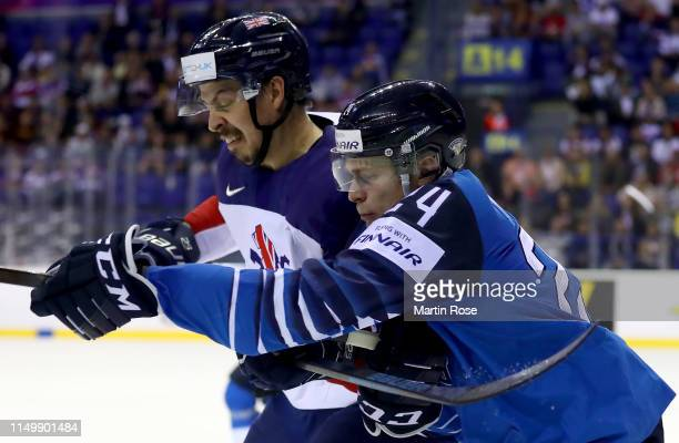 Kaapo Kakko of Finland challenges Dallas Erhardt of Great Britain during the 2019 IIHF Ice Hockey World Championship Slovakia group A game between...