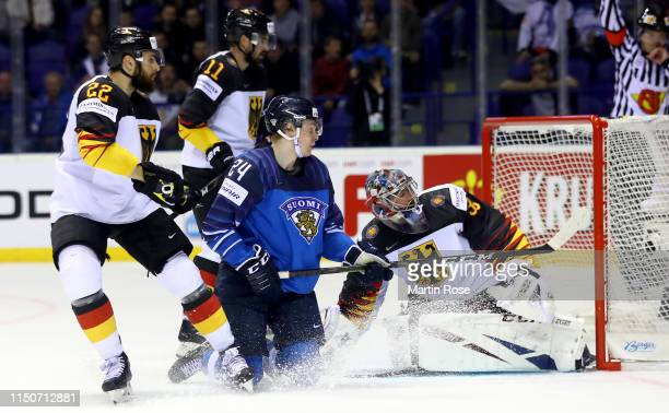 Kaapo Kakko of Finland challenges Philipp Grubauer goaltender of Germany during the 2019 IIHF Ice Hockey World Championship Slovakia group A game...