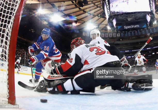 Kaapo Kakko of the New York Rangers scores a first period goal against Anders Nilsson of the Ottawa Senators at Madison Square Garden on November 04...