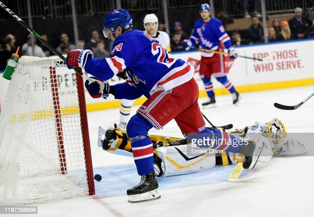 Kaapo Kakko of the New York Rangers scores a goal in overtime for a score of 3-2 during their game against the Pittsburgh Penguins at Madison Square...