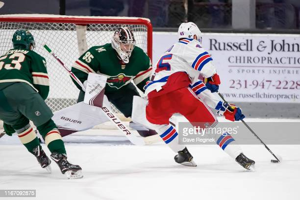 Kaapo Kakko of the New York Rangers skates around the net with the puck and scores the game winning OT goal on Hunter Jones of the Minnesota Wild...