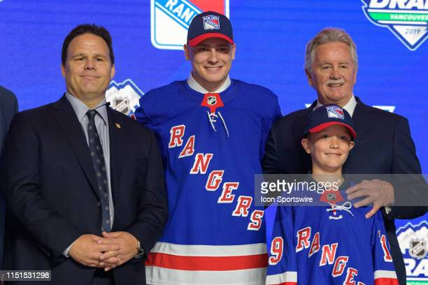 Kaapo Kakko poses for a photo onstage after being selected second overall by the New York Rangers during the first round of the 2019 NHL Draft at...