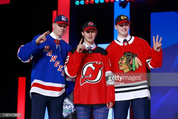 Kaapo Kakko second overall pick by the New York Rangers Jack Hughes first overall pick by the New Jersey Devils and Kirby Dach third overall pick by...
