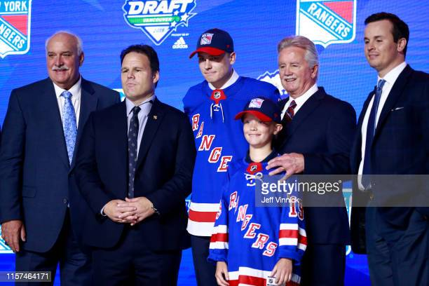 Kaapo Kakko second overall pick by the New York Rangers poses for a group photo with team personnel during the first round of the 2019 NHL Draft at...