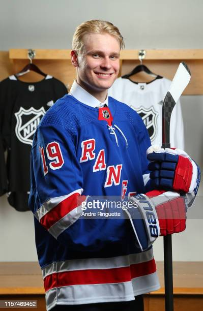 Kaapo Kakko second overall pick by the New York Rangers poses for a portrait during the first round of the 2019 NHL Draft at Rogers Arena on June 21...