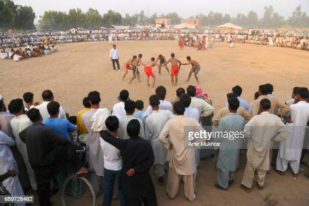 kabaddi (touch and go) - pakistan kabaddi stock pictures, royalty-free photos & images