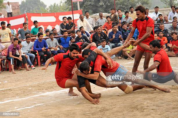 Kabaddi players compete against their opposite team during a Sadbhawana Kabaddi tournament held at Bisada on November 10 2015 in Dadri India The...