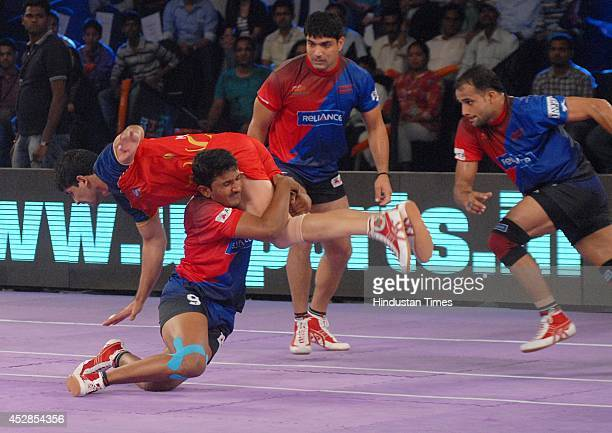 Kabaddi players of Puneri Altan and Dabang Delhi in action during the match of ProKabaddi league at NSCI Worli on July 28 2014 in Mumbai India Dabang...