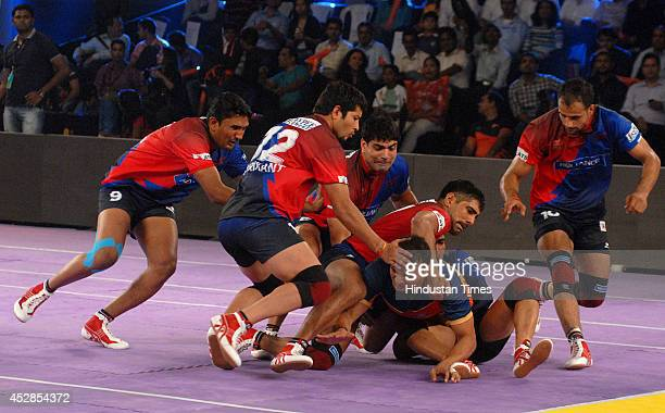 Kabaddi players of Puneri Altan and Dabang Delhi in action during the match of Pro-Kabaddi league at NSCI, Worli on July 28, 2014 in Mumbai, India....