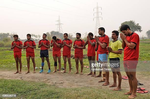 Kabaddi players prepare for their match during a Sadbhawana Kabaddi tournament held at Bisada on November 10 2015 in Dadri India The Sadbhawana...